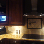 custom-fit-tv-in-kitchen-cabinet